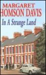 In a Strange Land - Margaret Thomson Davis, Pam Donald
