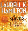 A Shiver of Light (A Merry Gentry Novel) by Hamilton, Laurell K. (2014) Audio CD - Laurell K. Hamilton