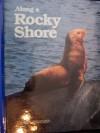 Along a rocky shore (Books for young explorers) - Judith E Rinard