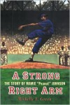 A Strong Right Arm: The Story of Mamie Peanut Johnson - Michelle Y. Green,  Kadir Nelson (Illustrator)