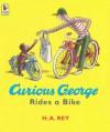 Curious George Rides a Bike - H.A. Rey