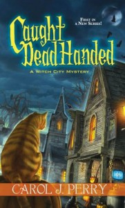 Caught Dead Handed - Carol J. Perry