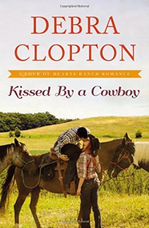 Kissed by a Cowboy (A Four of Hearts Ranch Romance) - Debra Clopton