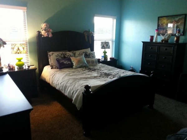 The awesome bedroom I call my sanctuary. I painted it all by myself and I love that color.