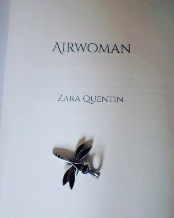 Airwoman with dragonfly