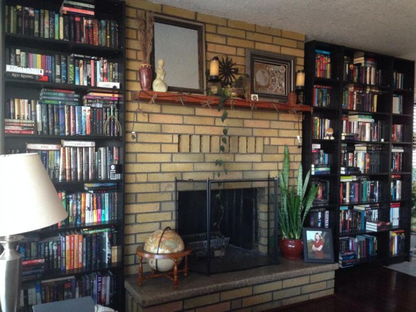 March Book Challenge Day 12: A Bookish Place There's no place more 'bookish' for me than my own home. I'm surrounded by an ever growing library. This picture represents just a portion of my books!