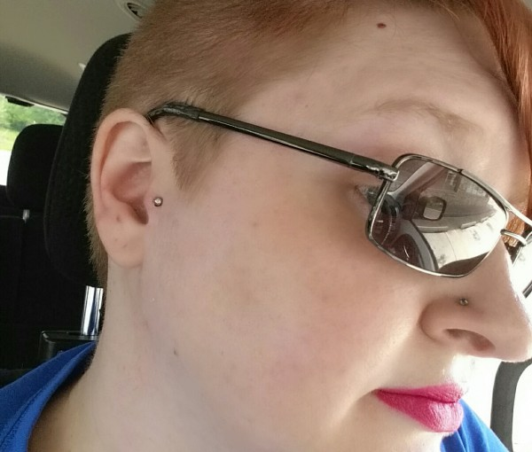To celebrate losing 50 pounds, I got my tragus pierced.