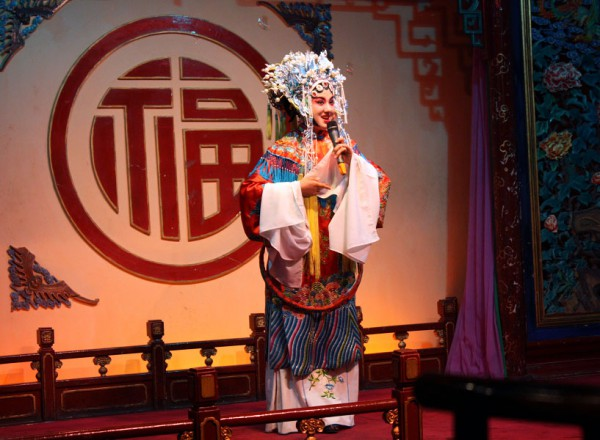 Beijing Opera performance at the Liyuan Theatre stage.