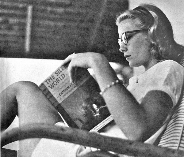 Grace Kelly (photographer and year, unknown), reading The Silent World, by Jacques Cousteau
