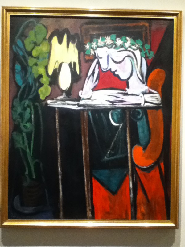 Girl Reading at a Table by Pablo Picasso