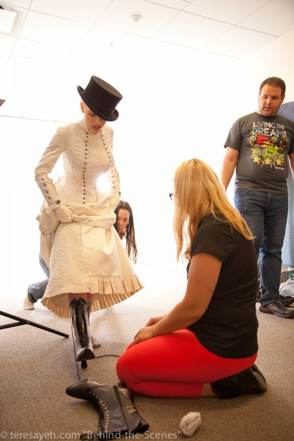 Nearly done: boots On. (Elizabeth Worth, model, Nadya Rutman in foreground, Cavalyn in back, Carl Rutman observing).