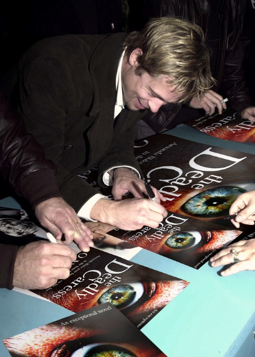 Brad Pitt signing my cover.