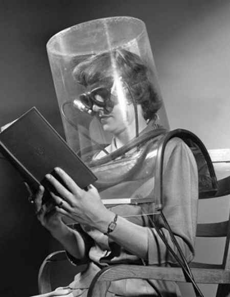 "Even in a weird, 1950s-style ""space suit"", reading is always cool."