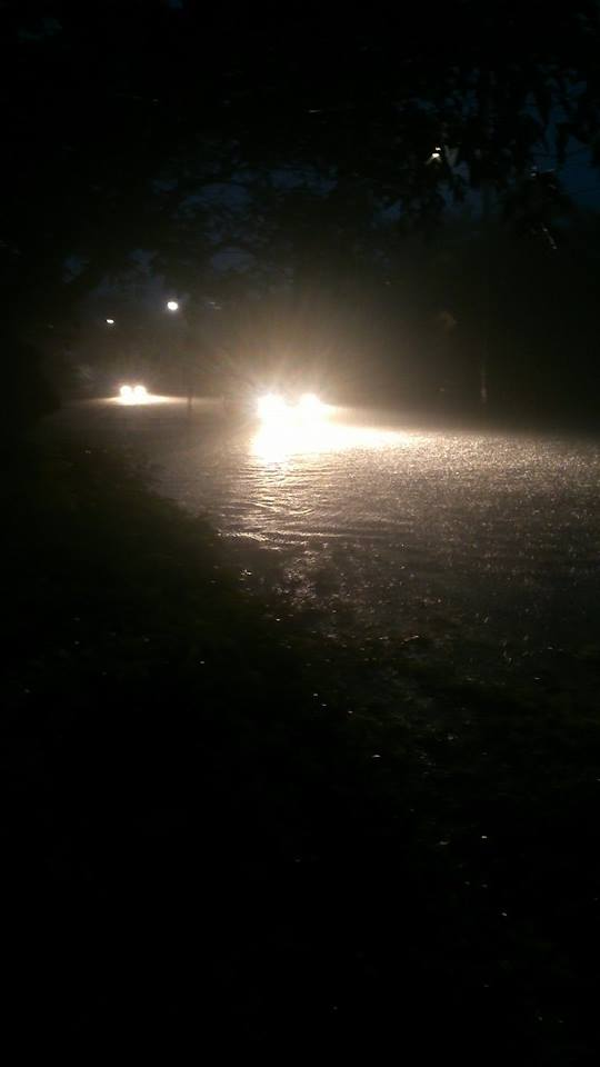 silly people, should know better than to drive in flood waters with a small car!!